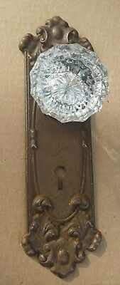 old door back plate with glass knob fastened to it. Hook