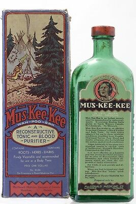 Circa 1920 Canadian green glass Mus Kee Kee tonic bottle with original box