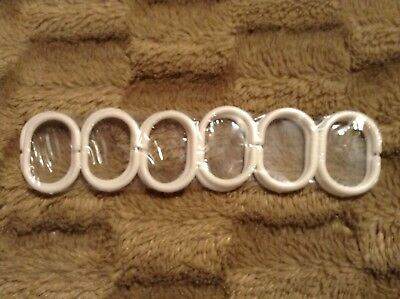 Set of 12 white shower curtain hooks brand new and unopened