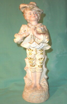 antique figurine of a boy with birds antique/ bisque/Germany