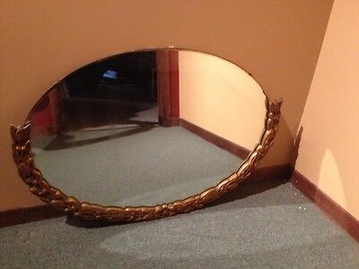 Vintage Handcarved Oval Mirror (25 inches by 38 inches)