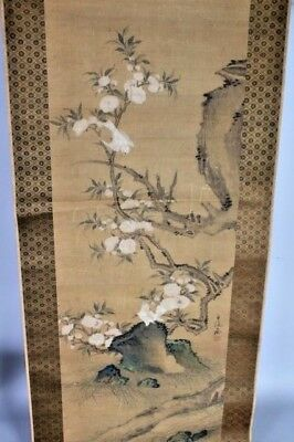 A Hanging Scroll Painting on Silk depicting a Pair of Birds Perched on Rockwork