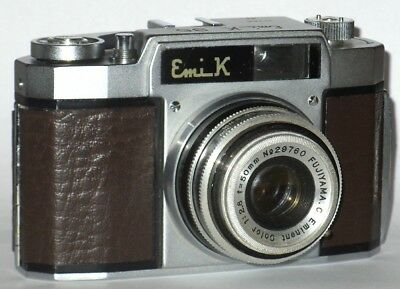 VINTAGE Emi K 35 CAMERA AND BOXED FLASH UNIT. BROWN COVERING