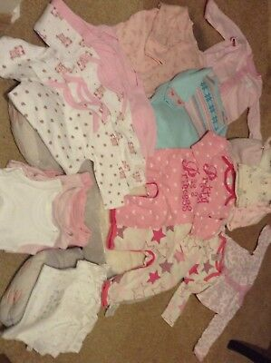 Large bundle of baby rompers, vests and hats 20 items