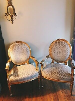 Pair of antique Louis XVI style gilt fauteuils a La Reine