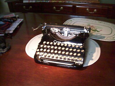 Very early Corona 4 portable typewriter and case.
