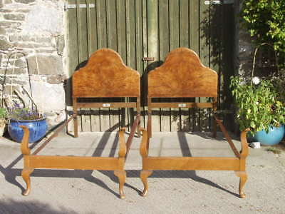 A pair of Burr Walnut quarter veneered Queen Anne single beds by Staples