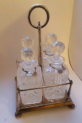 Silver Plated Decanter Stand With Four Labels and Four Cut Glass Decanters