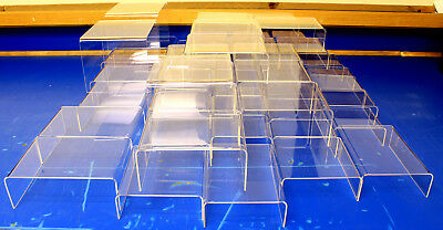 53 huge wholesale lot of clear acrylic display risers, mixed sizes, made in USA