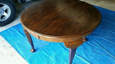 Antique round dining table, extendable