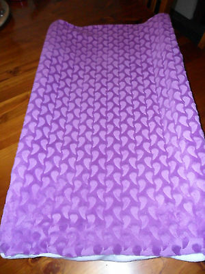 Violet raindrop with white ends.Fitted and removable nappy change cover.
