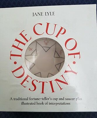 fortune telling tea cup reading cup and book
