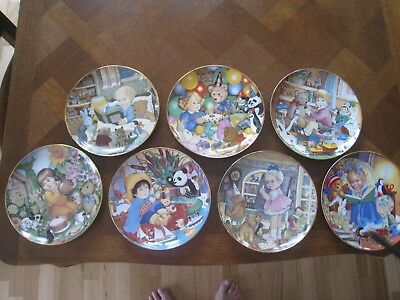 Set of Seven Carol Lawson Collector's Plates