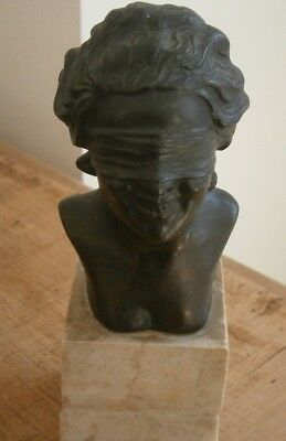 Bust by P Uccello on marble base