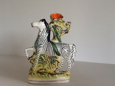 A 19th century hand painted Staffordshire spill vase with zebra & snake relief