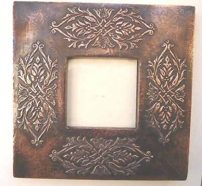 Arts & crafts? copper photo frame with four repousse floral motifs Strut stand