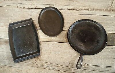 Vintage cast iron  griddles they're  round, oval and rectangle lot of 3