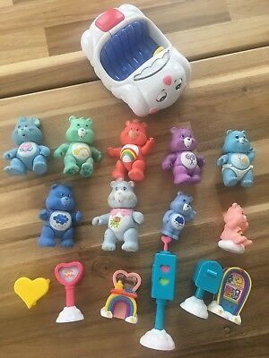 Vintage Care Bear Figurine Lot With car. 9 figurines, cloud car and signs.