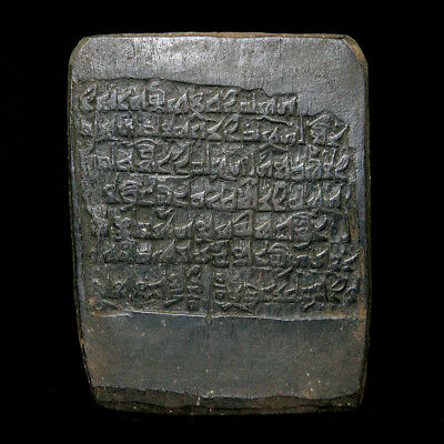 A carved wooden Tibetan ink-block with mythical beast and script. y2878