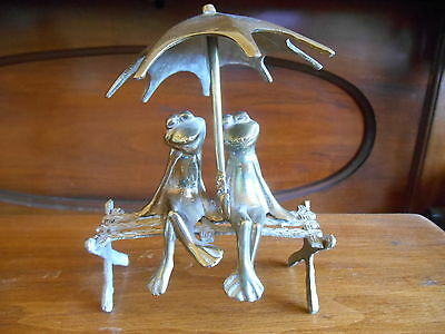 Brass Frogs on Park Bench with Umbrella