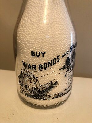 TRPQ 1943 Kahres Dairy black painted War Slogan milk bottle from Lansing, Mich.