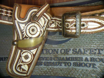 VIntage border style embroidered holster and matching cartridge belt