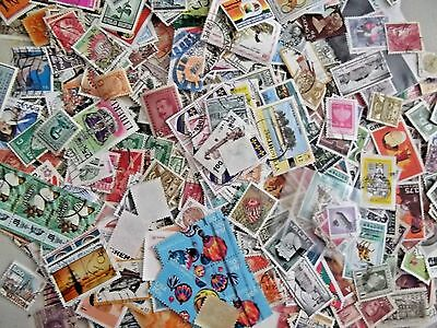 WORLDWIDE USED STAMPS OFF PAPER  LOT of 100 + STAMPS  SEE SCAN
