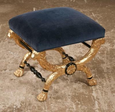 Gold gilt French Empire style stool with crossed legs having carved li... Lot 45