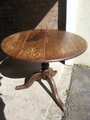 Antique oak tip tilt top dining table Very stable.Free local delivery.