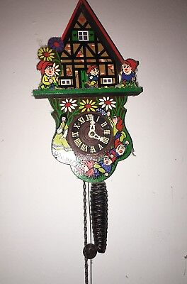 West German cuckoo clock with Snow White and the dwarfs