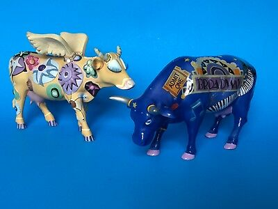 2 Cow Parade figures. Angelicow # 9127 & Broadway Cow. Dated 2000. Nice
