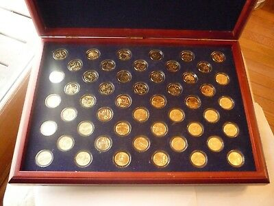 Gold state quarters, 50 in box.  The Morgan Mint.