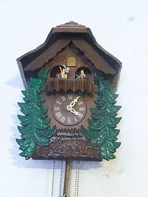 cuckoo clock musical,with hummel figurines dancers.CRYSTAL CLEAR MUSIC AND GONG