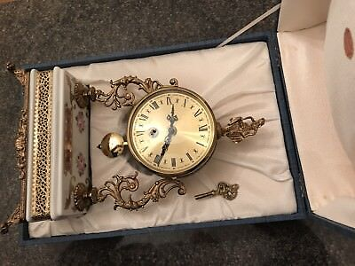 Vintage Italian ceramic and guilt 8 day clock working with original box