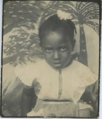 Black/african-American Photo Booth Portrait.  Scared Little Girl.