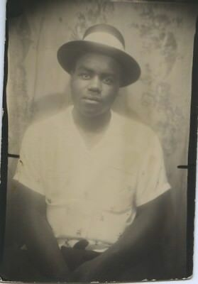 Black/african-American Photo Booth Portrait.  Disinterested Young Man.