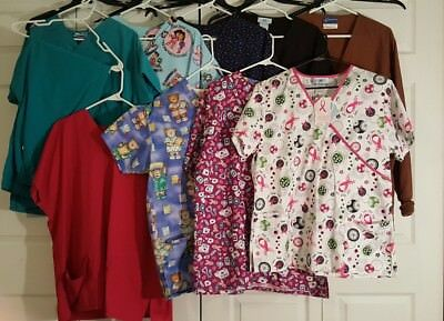 Lot of 11 women's size Large Scrubs, 2 tops are New w tags.