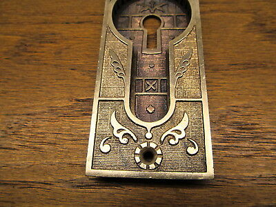 Brass ? Bronze ? Pocket Door Escutcheon...ornate