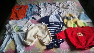 Lot of unisex baby clothes .