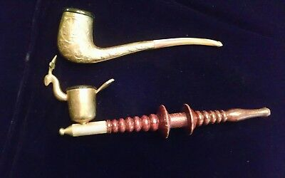 Asian decorative metal and wood smoking pipes. Turned wood - embossed metal.
