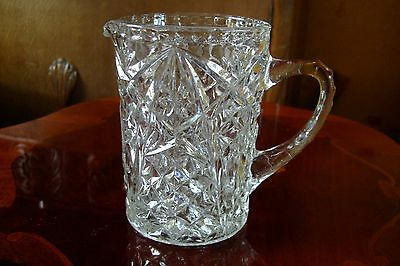 Vintage clear pressed glass jug. Large with nice pattern.  Retro.