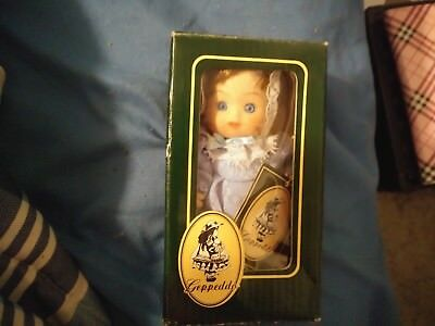 Geppedo Small Antique Porcelain Doll, good condition still in box.