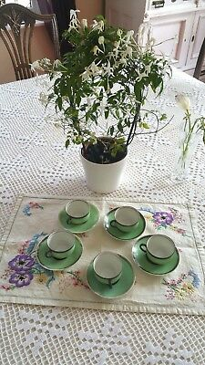 Vintage sterling silver rim on porcelain with  coffee cups and saucers
