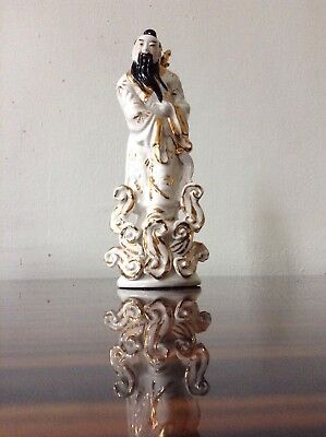Vintage Oriental Chinese Figurine with Sword White China and Gold Gilt.