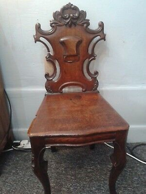 Antique mahogany hall chair with carved shield shape back. Antique chair