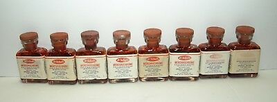 Vintage 1951 Dr. Scholl's Mercurochrome 8 bottles from old Rexall drug store.