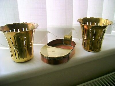 A pair of arts and crafts plant pot holders and copper/brass chamber stick