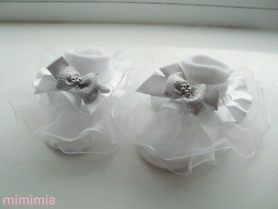 baby frilly white socks, white frill  1 silver satin ribbon bow  1 silver bow .
