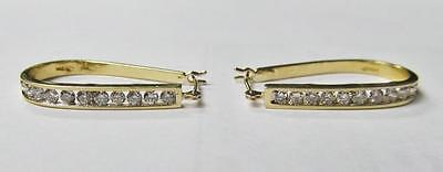 Ladies 14 Karat Yellow Gold Diamond Hoop Earrings