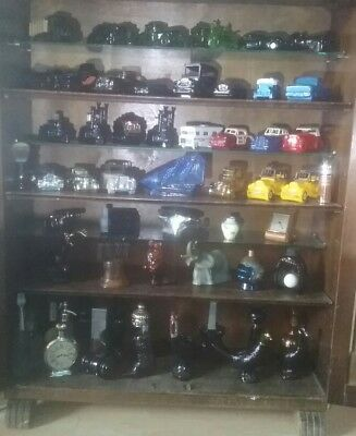 over 150 avon collectible bottles, candle holders, some with boxes